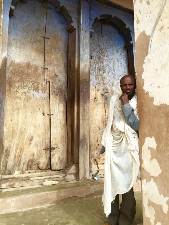 Ethiopia church door and caretaker in Gheralta - Africa safari adventure