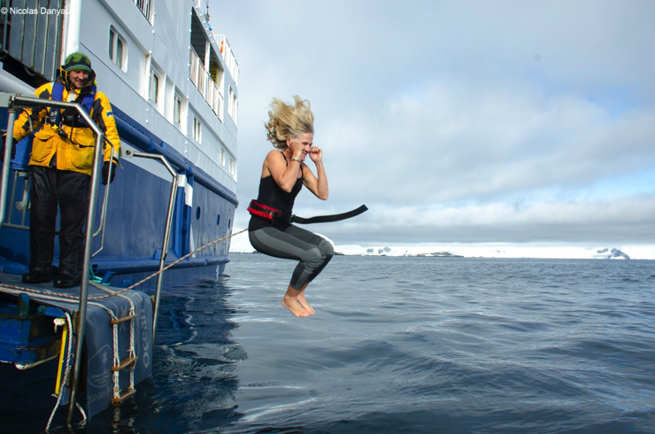 Annie taking the polar plunge - Epic Antarctica