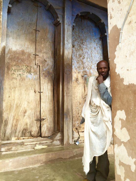 Ethiopia church door and caretaker in Gheralta - Africa safari adventure