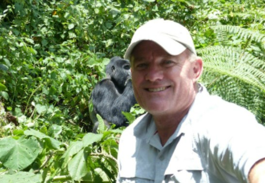 Rob with silverback gorilla in Uganda